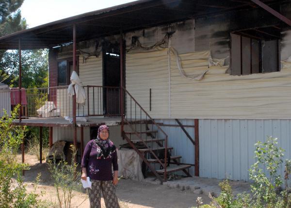 Evi yanan kadın yardım istedi