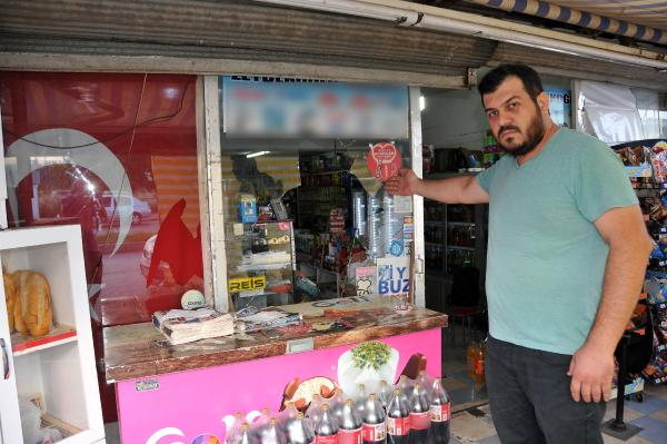 Türk bayrağı asılı marketi yakmak istemişler